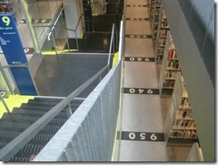 Starting down to the book spiral, so called because you can walk through it without using stairs.