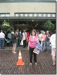 Kate standing by the original Starbucks. She went there on Sunday.