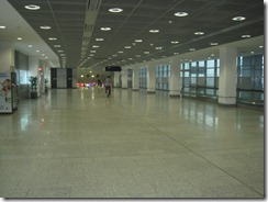 Distant shot of an employee bicycling through Frankfurt Airport