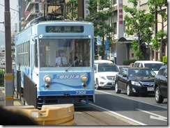 Blue streetcar with a female engineer.