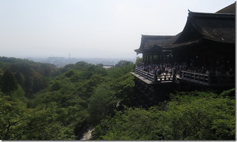 The view of Kiyomizu-dera's grand balcony with Kyoto's skyline in the distance.
